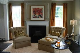 an open concept living room in carpet with mustard colored walls