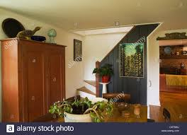 partial view of the dining room with an antique armoire in an old