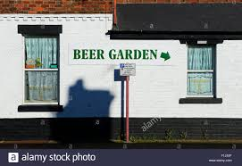 sign beer garden on wall of pub england uk stock photo