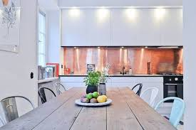 sleek copper kitchen backsplash with white cabinets copper