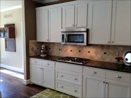 Stacked Stone Kitchen Backsplash Kitchen Backsplash Kitchen Designs White Cupboards What Color