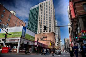 in boston s chinatown longtime residents face an uncertain future the kensington apartments and millenium place condominiums behind tower over chinatown at the intersection of stuart kneeland and washington streets in