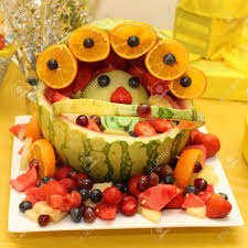 fruit basket art shaped as a baby for baby shower stock photo