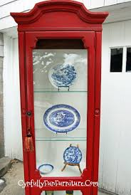 colonial red curio cabinet for towels and toiletries the kitchen or dining room for china the family room or living room for books and collectibles or even as an entryway piece