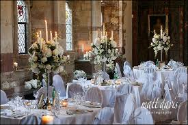 wedding flowers gloucestershire wedding candelabra filled with flowers taken at berkeley castle