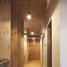 basement hallway illuminated with contemporary wall sconces