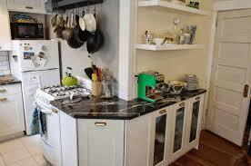 wall mounted white wooden shelf l shaped white kitchen island