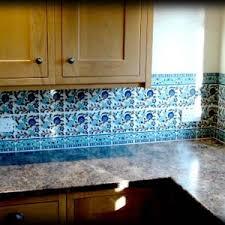 elegant blue color ceramics tiles kitchen backsplashes featuring