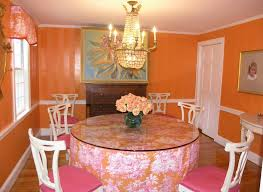stripped rug on the wooden floor of light orange dining room has