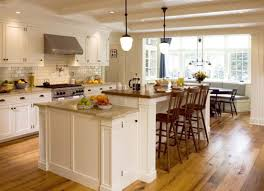 l shaped kitchen with cool cream cabinets idea and unique pendant great island with seating idea plus couple low ceiling lights and modern cream kitchen cabinets kitchen