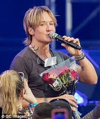 keith urban shows off his tattoos as he takes to the stage in la
