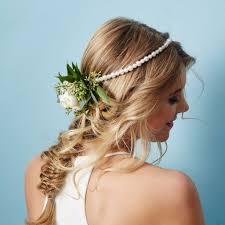 bridal hair flowers unique ways to wear wedding hair flowers popsugar beauty