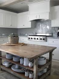 white kitchen wood island reclaimed wood countertop cottage kitchen luby