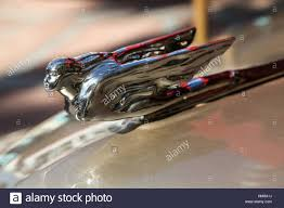 the ornament of a car shaped like a person with wings stock