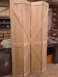 make bi fold doors look like rustic barn doors cheap easy diy
