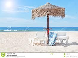 Beach Sun Umbrella Wooden Beach Umbrella And Sun Bed On The Beach Royalty Free Stock