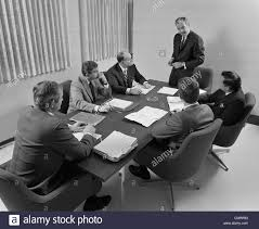 Executive Meeting Table 1960s 6 Executive Businessmen Around Conference Table Board