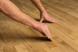 how to fix hardwood floor gaps