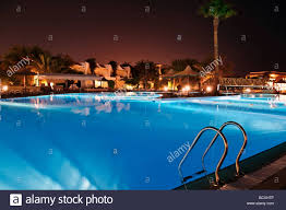 resort with pool at night view stock photo royalty free image