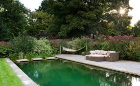 decking over pond pool traditional with deck person outdoor bistro