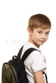 10 years boy with a backpack isolated on white background