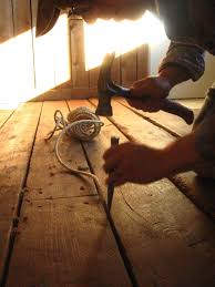filling wood floor gaps diy how to fill gaps in plank wood floors sage and scarlet