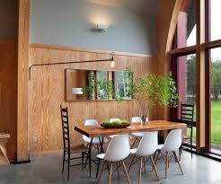 sloped arm barrel dining room modern with wainscoting contemporary