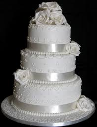 cake decorating techniques 4 tier white wedding cake with white