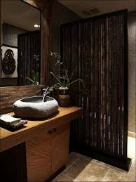 tropical bathroom with stone vessel sink and bamboo divider