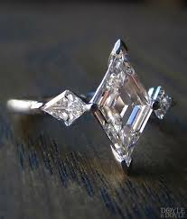 spectacular art deco style lozenge cut diamond engagement ring