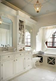 traditional bathroom with wallpaper and wainscoting a beautiful