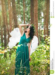 beautiful with angel wings in the forest stock photo image