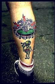alien and spaceship tattoo on leg photo 1 photo pictures and