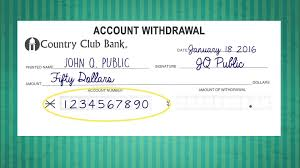 filling out a withdrawal slip
