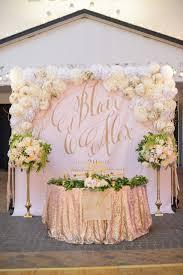 wedding backdrop design sweetheart table backdrop with large gold calligraphy monogram
