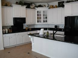 decorations black granite countertop and beige mozaic tile with