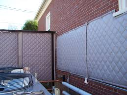 reduce outdoor noise with a sound blocking fence acoustical