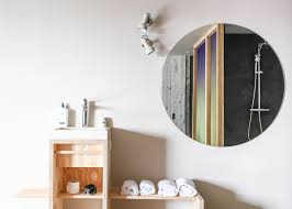 hanna maring u0027s volkshotel suite has a wooden bathtub and colourful