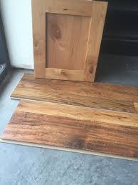 what color flooring goes with alder cabinets knotty alder cabinets doors trim and laminate wood floor