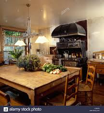 victorian style pendant lamps over old wooden table and chairs in