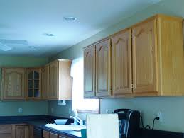 Kitchen Cabinet Upgrades by Diy Kitchen Cabinet Upgrade With Paint And Crown Molding