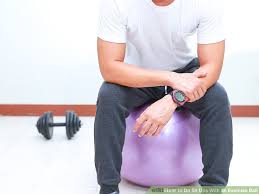 Sitting On A Medicine Ball At Desk 4 Ways To Do Sit Ups With An Exercise Ball