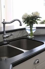 brushed nickel faucet with stainless steel sink honed granite countertop with stainless steel sink and polished
