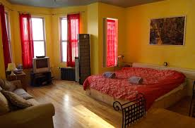 small bedroom new york apartments with wooden floor and sofa