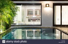 hotel suite with pool inside door to bathroom in background