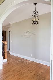 foyer with behr sculptor clay and silky white trim paint it