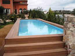 swimming pool wooden deck with steps of backyard oval above