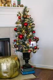 flank the fireplace mantel with a small 4 5 ft tree