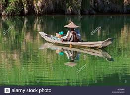 myanmar burma lay mro river a rakhine man fishes from a small