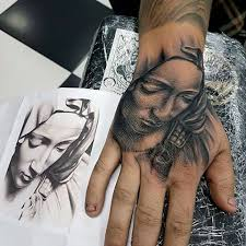 stonework style black ink hand tattoo of sad woman in hood